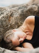 Woman lying on rocks at cliffs