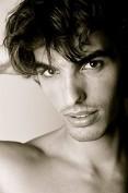 Hawaii, Kauai, North Shore, Handsome Male Model Poses In Studio.