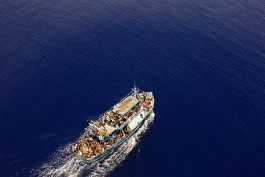 Sicily - Illegal Immigration - Large loaded immigrant vessel
