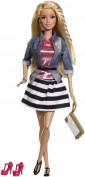 Anche Barbie, dopo anni e anni ti tacchi alti ha deciso di abbandonarli in favore un paio di più comode ballerine.. sperando che queste, per la gioia di tutte le bambine, rimangano ben salde ai piedi della bambola...