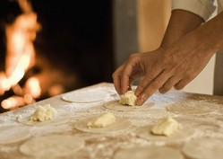 Cook filling pasta dough in kitchen