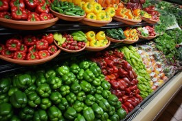 Rows of Colorful peppers for sale in a large Supermarket in the USA