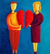 Unhappy Couple holding broken heart