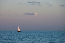 moonrise over yacht on calm water. Image shot 2008. Exact date unknown.