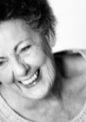 Elderly woman laughing, portrait, close-up, black and white