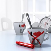 Two mugs with I Love U and a red cross on the one at the foreground, conceptual 3D render