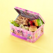 Healthy Childrens Lunch Box with mashed banana and dried date sandwich