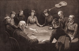 People at a seance appear to experience a guitar floating above their heads and a ghostly hand writing on paper, circa 1887.