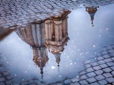 Sant'Agnese in Agone church in Piazza Navona reflected in pool of water, Rome