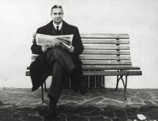 Aldo Moro sitting on a bench